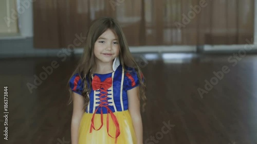 Cute girl in costume of the Thumb Princess posing at camera