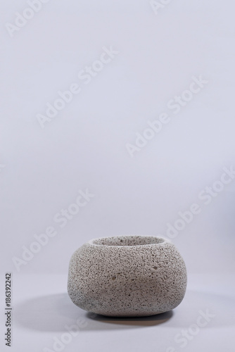 Foto op Canvas Zen Concrete vase sphere on isolated white background
