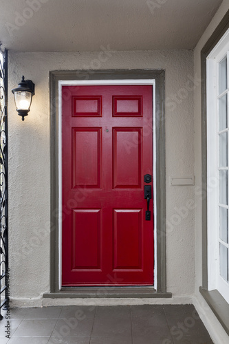 Red entry door / front door with door viewer and Venetian Bronze Single Cylinder Sectional Handleset.