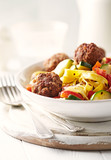 Tagliatelle with vegetables and meatballs - 186425831