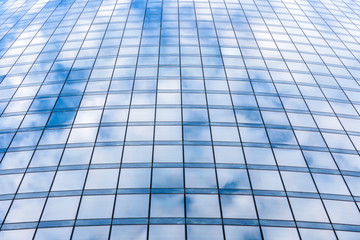 The sky is reflected in a modern skyscraper