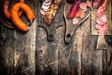 Different kinds of salami on the boards. - 186429678