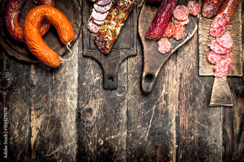 Different kinds of salami on the boards.