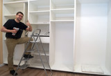 Smiling Service man at the time of assembling of built-in wardrobe. - 186430065