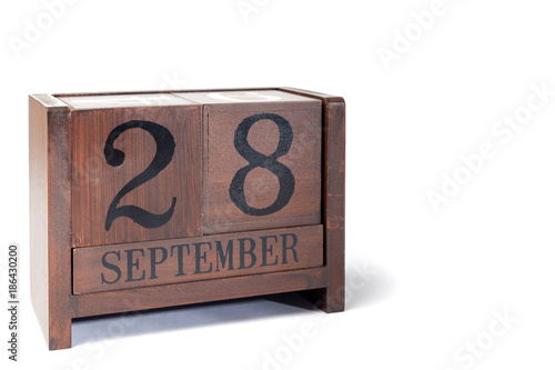 Poster Wooden Perpetual Calendar set to September 28th