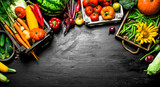 Organic food. Fresh vegetables and fruits in old boxes. - 186430433