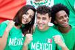 canvas print picture - Drei lachende mexikanische Fussball Fans mit Fahne