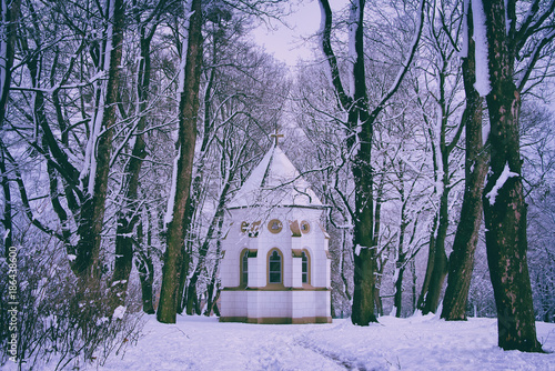 Aluminium Purper beautiful chapel among trees in winter season, snow covered religious monument in alley