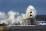 Waves crashing over Seaham Lighthouse poster