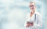 Young doctor woman smile face with tablet stethoscope and white coat - 186443261