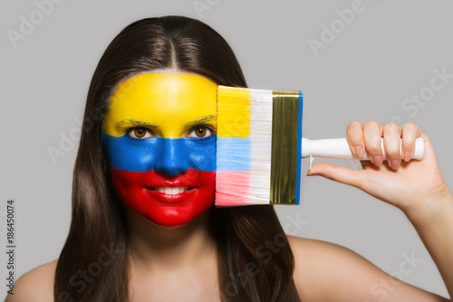 Fotobehang Voetbal The face of a woman in the national colors of Colombia