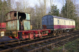 Train carriage abandoned on old railway disued steam engine - 186460820