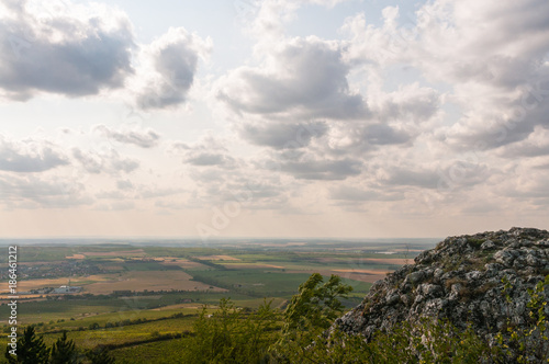 Foto op Canvas Wit boulder on the hill with blue sky and nice clouds in background