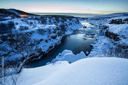 Fotobehang Natuur Hraunfossar waterfall in winter, Iceland.