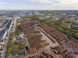 Aerial view over woodworking site in industrial neighbourhood, Alytus, Lithuania. During cloudy summer day. - 186467098
