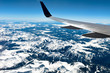 Flying Over Colorado Rockies - Aerial view of snow-capped Rocky Mountain Ranges in Colorado, USA.
