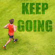 "Running fitness inspiration motivation message written on grass texture. Man runner with text ""KEEP GOING"" on background for motivational quote. Creative design quotes for social media."