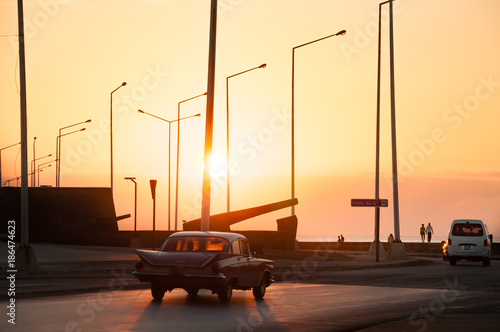 Tuinposter Havana Sunset on the Malecon in Havana on a daily day in Cuba