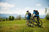 ACTIVE Young couple biking on a forest road in mountain on a spring day - 186478065