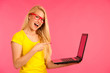 Beautiful young woman holds a laptop gesture surprise and success isoalted