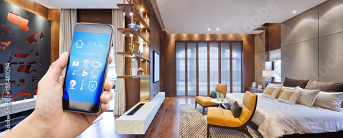 Foto Murales smart phone with smart home with modern bedroom