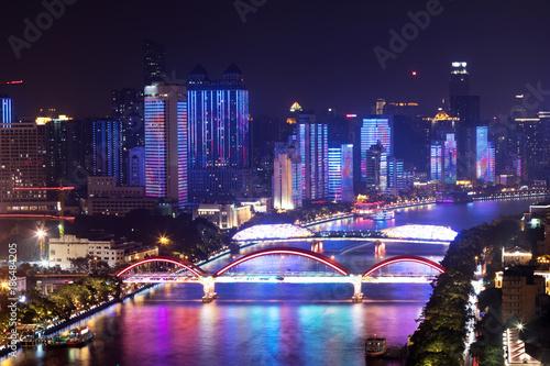 Foto Murales modern buildings along long river