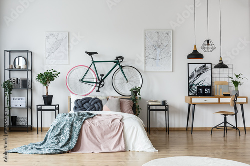 Bicycle and cushion in bedroom - 186487007