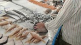 a fishmonger cuts up a fish into cutlets at athens central market in greece - 186495687