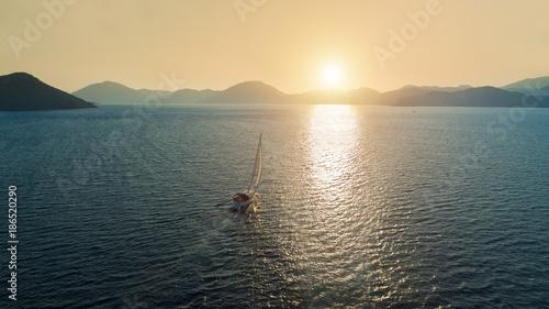 Boat sailing into the sun in Mediterranean Sea - 186520290