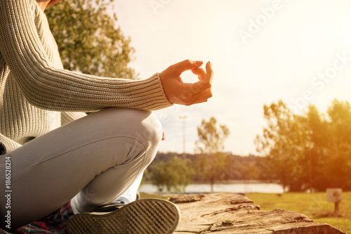 Obraz na płótnie Practicing Yoga and meditating during sunny morning.