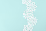 decorative christmas snowflakes, isolated on light blue with copy space - 186536079