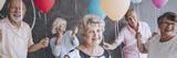 Senior people celebrating friend's birthday - 186547693