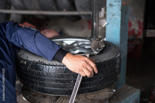 Dish brake of vehicle, Mechanic changing a wheel of a car