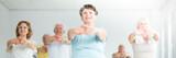 Smiling elderly woman stretching - 186548095
