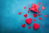 Gift box and red hearts for Valentines day background. Top view. Flat lay.