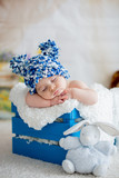 Little baby boy with knitted hat, sleeping with cute teddy bear - 186557853
