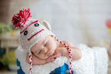 Little baby boy with knitted hat, sleeping with cute teddy bear - 186557891