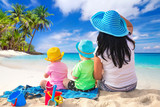 Mother with twins on the tropical beach holidays - 186566219