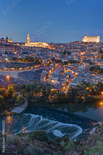 View of Toledo in Spain with the Tagus river at dusk © elxeneize