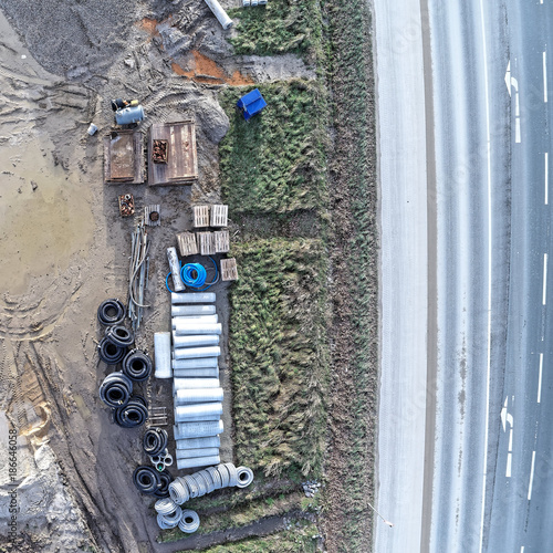Aerial view of the material store for canal construction work on the construction site of a new development area - 186646058