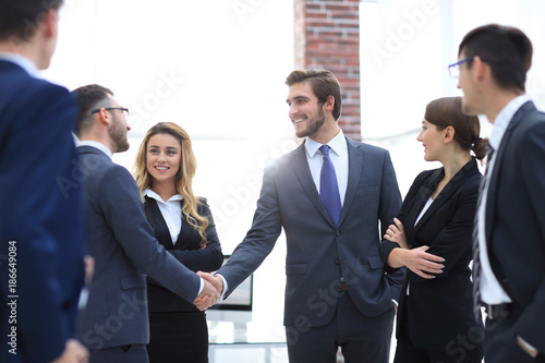 business handshake of businessmen in the office