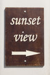 Brown wooden sign with the inscription sunset view