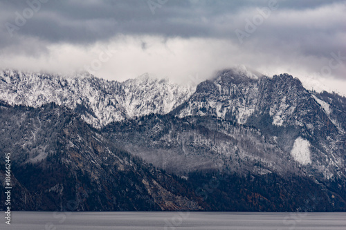 Foto op Canvas Natuur Winter landscape. Snow covered mountain range and lake.