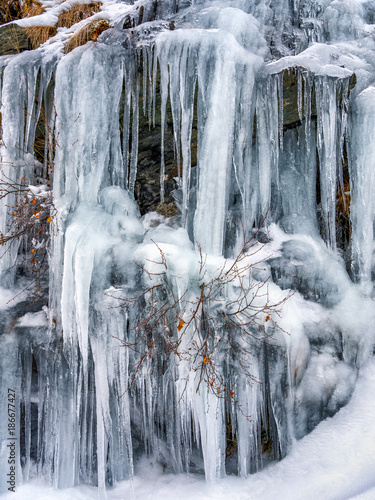 Fotobehang Bleke violet Frozen waterfall in wintertime