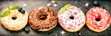 Donuts glazed with various sprinkles. Sweet food background
