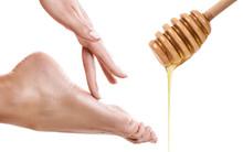 Honey Flows Down From Spoon Near Female Foot Sticker