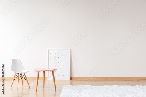 Empty room with small furniture