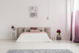 White lamp above bed