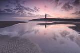 purple sunrise over North sea beach and lighthouse - 186706086