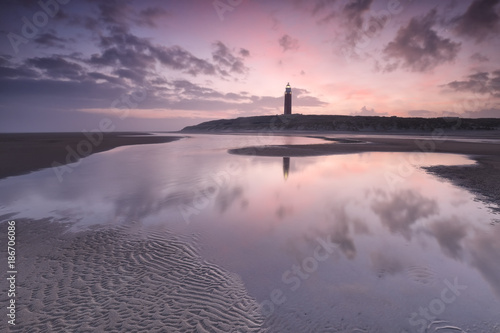 purple sunrise over North sea beach and lighthouse Poster